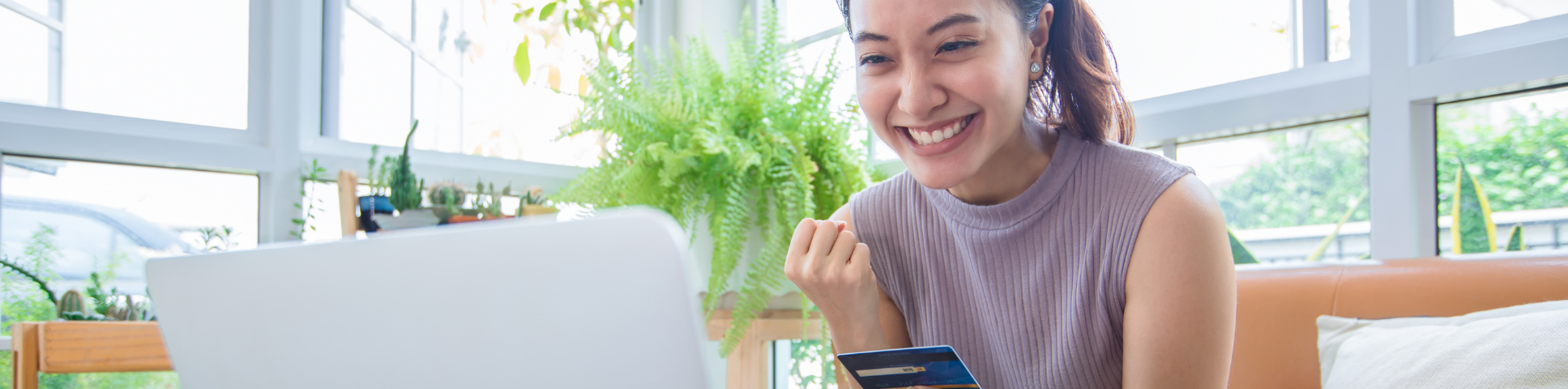 Lady smiling with credit card